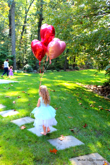 Each guest left with a Queen of Hearts balloon in their choice of red or pink