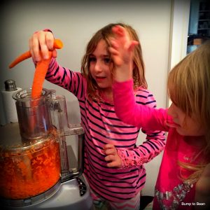 Grating the carrots in the food processor makes the task quick and tidy